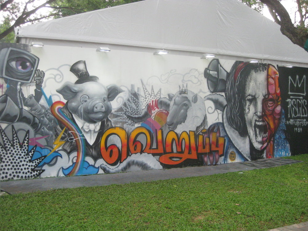 Graffitti artists in full flow during the festival