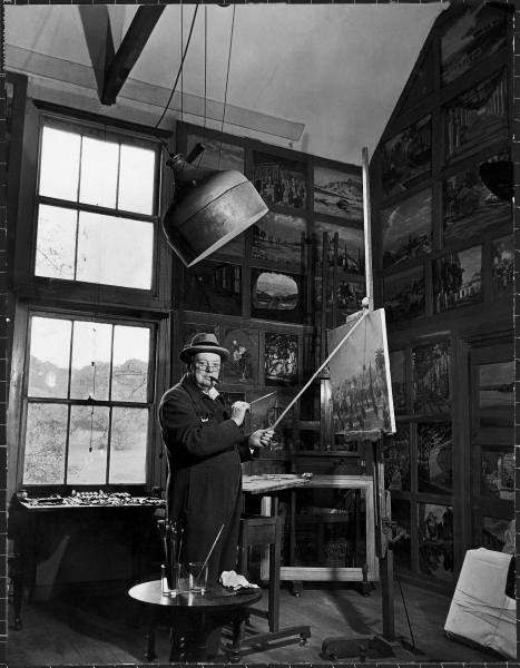 "workspaces :      i12bent :       Winston Churchill Painting        1945   (Photograph by Hans Wild)   Caption: ""Former PM Winston Churchill smoking a cigar as he stands in his studio dressed in his blue RAF siren jump suit while touching up one of his landscape paintings at his country estate Chartwell in Kent.""   (via Life)"