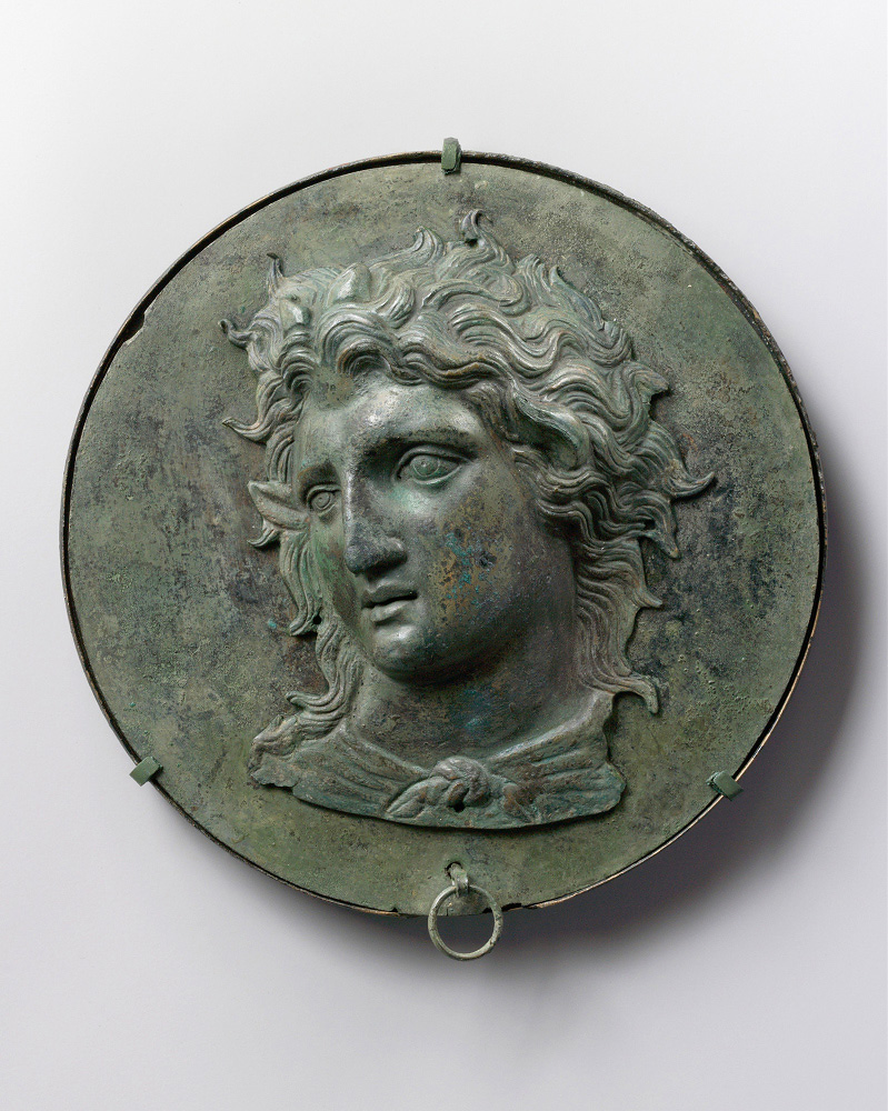 990000 :      Head of Pan    Greek bronze box mirror late 4th century B.C.   Metropolitan Museum of Art