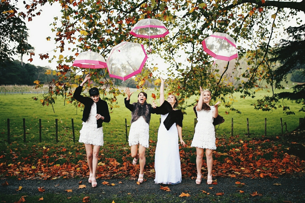 The ladies making it rain...umbrellas haha.