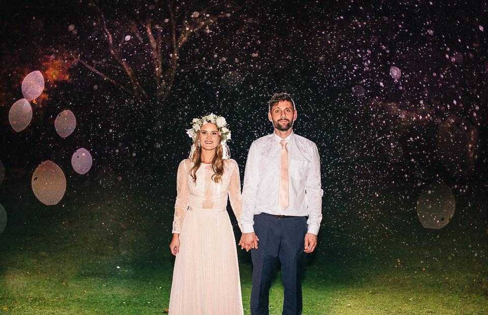 Kate + Rhys standing in the rain at Tarureka Estate