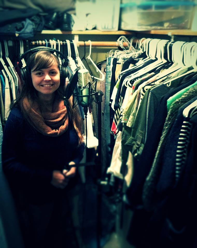 Mrs. Something showing off our elite vocal isolation booth: our closet.