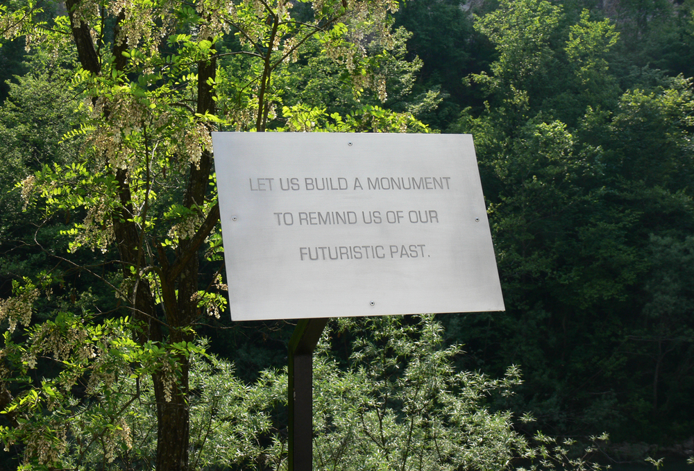 A Sign For Remembrance, 2011, engraved aluminum and steel. 125 x 50 x 35 cm. Installation view 1st Time Machine Biennale of Contemporary Art. D-O ARK Underground, Konjic, Bosnia and Herzegovina