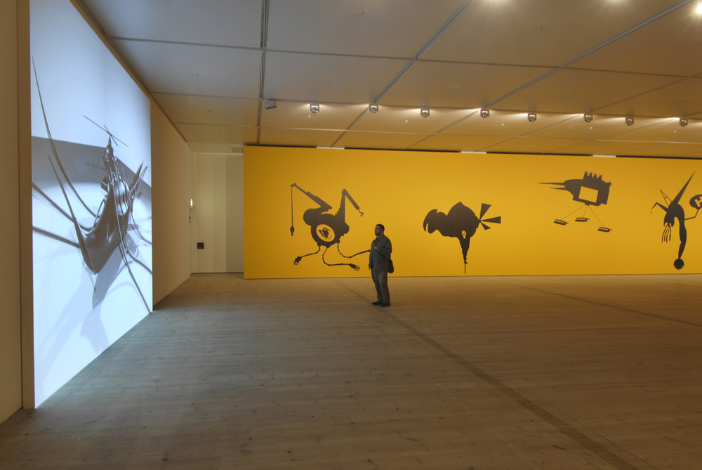 "The Bride Stripped Bare by Her Energy's' Evil, 2006, two large scale wall paintings (10 m each + acrylic colors), audio elements and a projected short 3D animated film,  2 min. 44 sec. Installation view at BALTIC Centre for Contemporary Art, Gateshead, UK. Credits: Image by Colin Davison                                   Normal     0                     false     false     false         EN-US     JA     X-NONE                                                                                                                                                                                                                                                                                                                                                                                                                                                                                                                                                                                                                                                                                                                    /* Style Definitions */ table.MsoNormalTable 	{mso-style-name:""Table Normal""; 	mso-tstyle-rowband-size:0; 	mso-tstyle-colband-size:0; 	mso-style-noshow:yes; 	mso-style-priority:99; 	mso-style-parent:""""; 	mso-padding-alt:0in 5.4pt 0in 5.4pt; 	mso-para-margin:0in; 	mso-para-margin-bottom:.0001pt; 	mso-pagination:widow-orphan; 	font-size:12.0pt; 	font-family:Cambria; 	mso-ascii-font-family:Cambria; 	mso-ascii-theme-font:minor-latin; 	mso-hansi-font-family:Cambria; 	mso-hansi-theme-font:minor-latin; 	mso-ansi-language:EN-US;}"