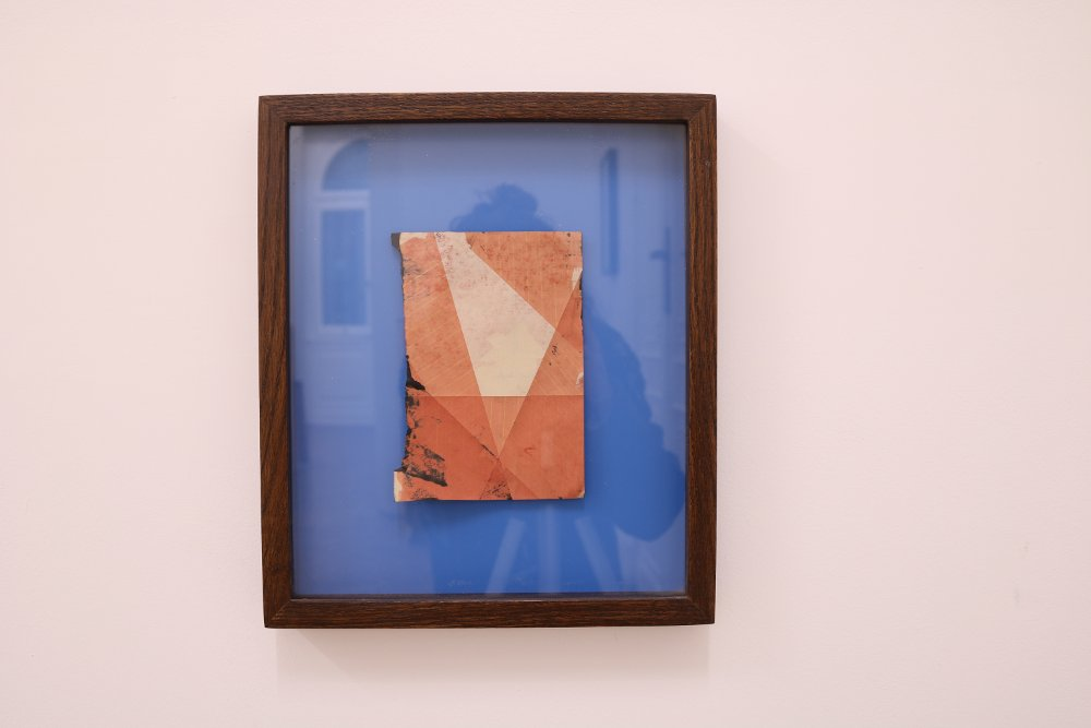 Untitled, 2016, Framed inkjet on book page with flat blue laminate backing, 16 cm x 12 cm