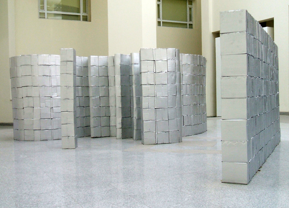 Sona El Seen - Made in China, 2009, 1500 Cardboard boxes construction silver colour, 1200 x 80 x 180 cm. Courtesy of the artist and Gypsum Gallery.