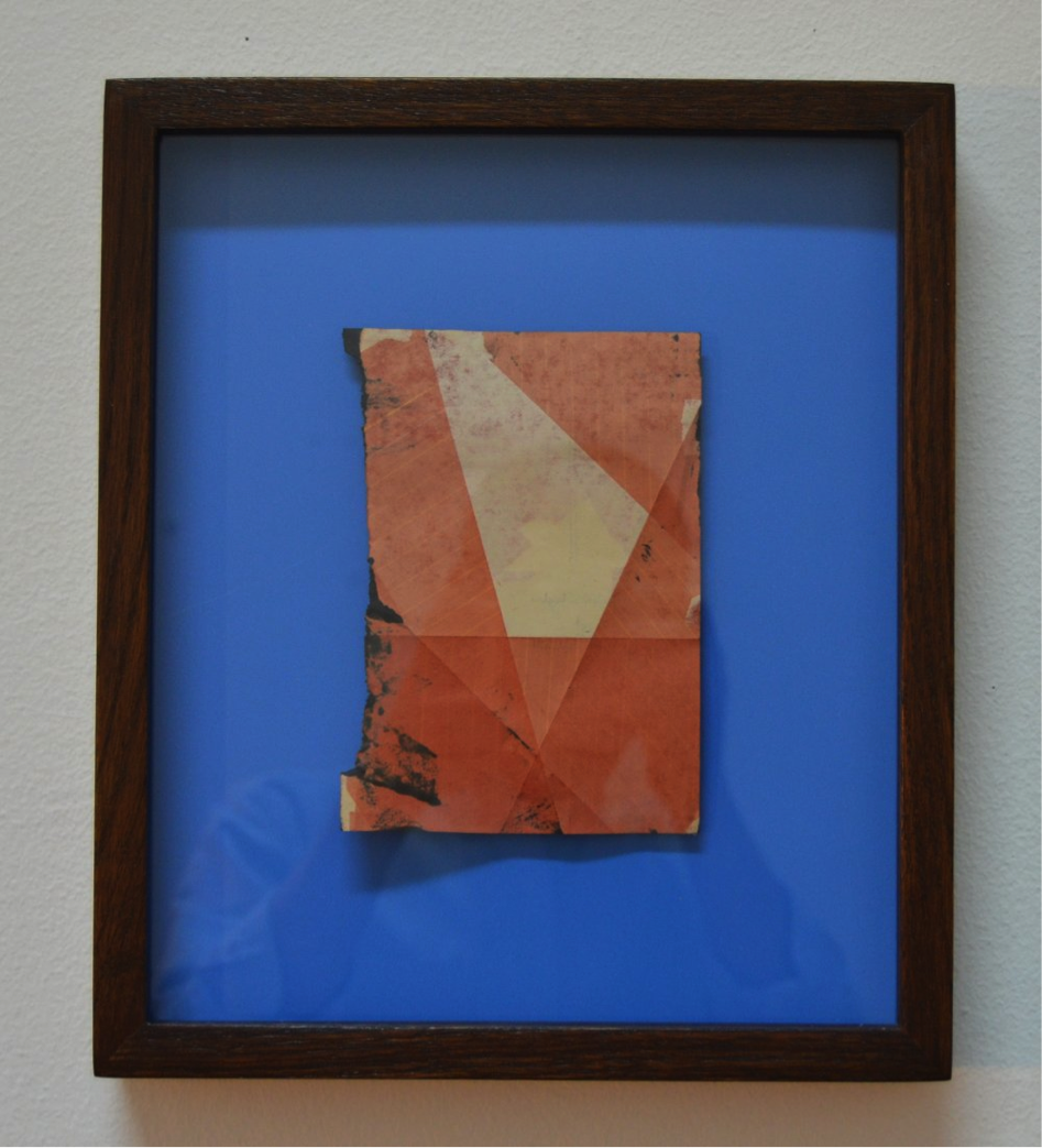 Untitled, 2016, Framed inkjet on book page with flat blue laminate backing, 16 cm x 12 cm.
