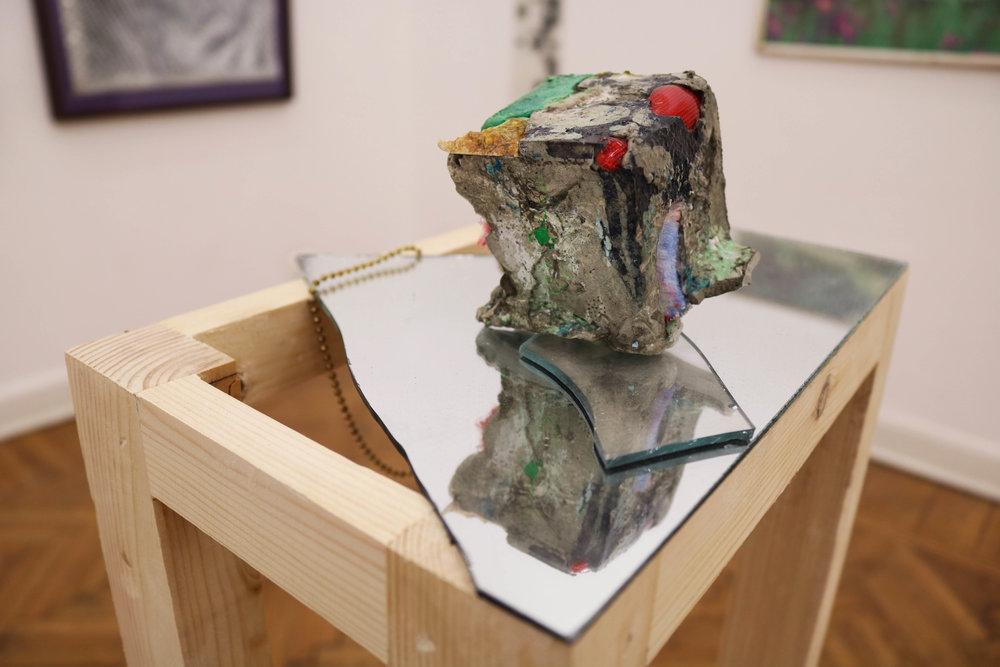 Paperweight #7, detail, 2016, variable materials, variable dimensions, concrete cube 6 x 6 x 6 cm, wood pedestal structure, 20 cm x 30 cm x 105 cm.