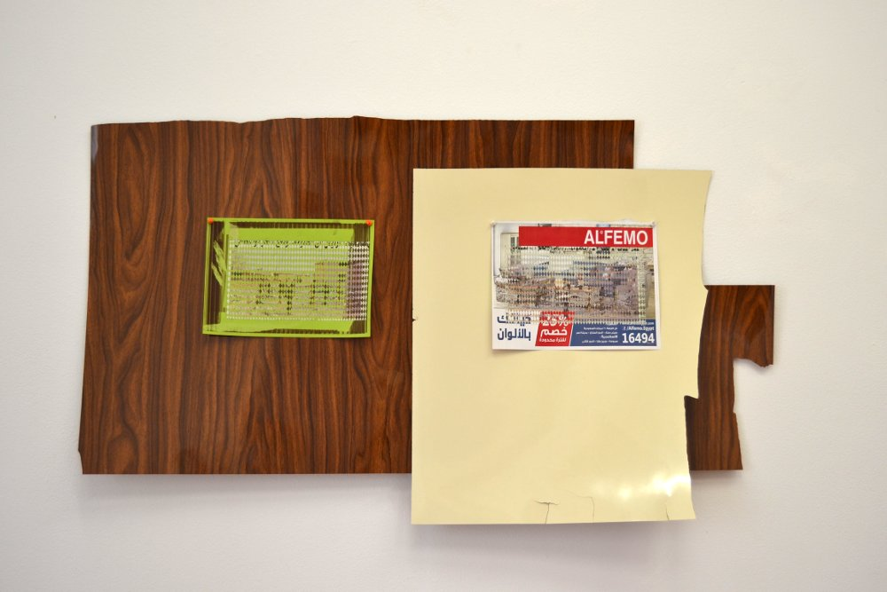 Untitled (Al Sharq Al Awsat), part 1 and 2, 2015/16, materials: Plastic laminate, newspaper on paper, newspaper on magazine advertisement, pins (installation view), variable dimensions. Photo: Nile Sunset Annex.