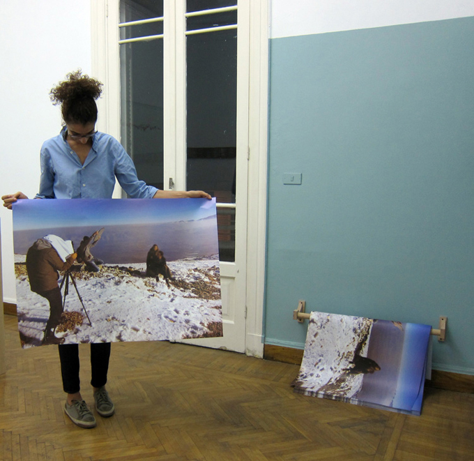 Please Stay Blurry, 2013, Offset print, 100 x 70 cm giveaway poster, edition of 500, wooden rod installed close to the floor. Installation view, Nile Sunset Annex, Cairo, Egypt.