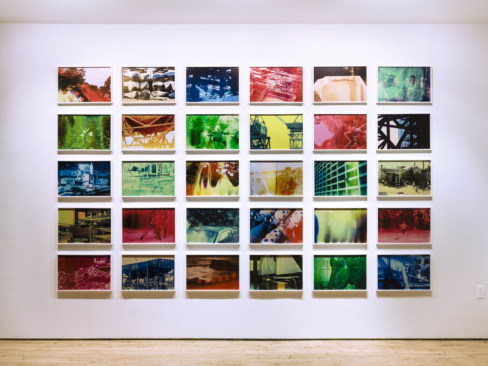 The Hollow Desire to Populate Imaginary Cities, 2014, 30 C- Prints from chemically altered slides on metallic paper, 34 x 50 cm each, Edition 3 + 1AP Installation shot of Exhibition at Art in General , NYC, 2014- 2015.