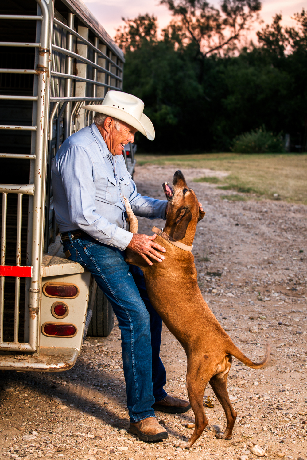 "September 1, 2013 - White River Lake, TX Canon 6D, 14mm f/2.8 This is a portrait I shot of my grandpa, Harvey Cannon, and his dog, Penny. Although this wasn't taken at the end of the year, it's probably one of the last significant photos I took last year.  I took it as around my grandpa's birthday, because: 1. I am TERRIBLE at buying gifts (I even get stressed at buying a card,) 2. I realized that I didn't really have any current, good photographs of my grandpa.  My uncle recently scanned several photographs from the 60's and 70's, so we have a lot of older photographs from my mom's childhood, but in terms of nice photographs that are better than, say, an iPhone pic, there aren't any. Little did I know that that point the value of this photograph.  Last month my grandpa was out doing a routine replacement of a water pump pressure tank. The bottom of the tank was rusted out unbeknownst to my grandpa, and it exploded upwards, shattering the area around his nose and cheeks.   He survived it, but he's VERY lucky. He said that when it first happened he landed on his back, and because of his injuries, if he had lost consciousness, there was a high chance that he would have suffocated due to his injuries. This is probably the first time that I realized firsthand how important photography is. Although I do not like to say that we ""capture memories"" (cliche, cliche, cliche), that is kind of what we do. There are many uses for photography from communication to art to advertising, but one of the most common is just simply photographing for posterity. Sometimes that's all a photo needs to be for, too. Today it seems like so many photographers take more photographs of other people than they do their own family"