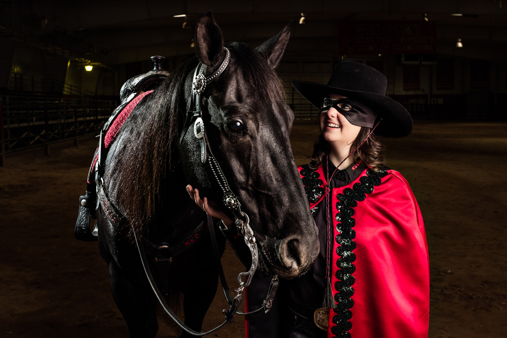 Mackenzie White, the 2014-2015 Masked Rider for Texas Tech University