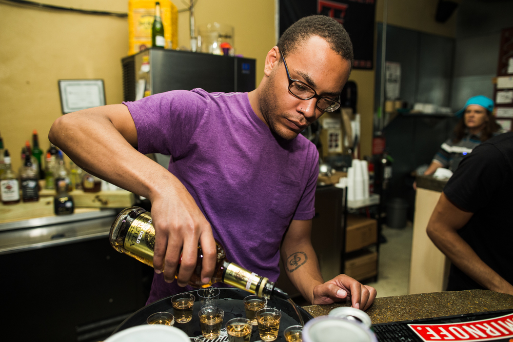 Leon Eldridge pours shots for a group of customers July 19, 2013, at Belly's Cafe in Lubbock, Texas.