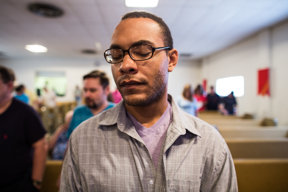 "Leon Eldridge closes his eyes in prayer during a Sunday service at the Metropolitan Community Church.    Eldridge said his parents are both very spiritual and religious. He said his father was a preacher, although not officially ordained by a church, while his mother studied theology.    ""The God perception has always been really important in my family,"" Eldridge said, ""and I've always been very lucky to find churches that I have felt extraordinarily nurtured by."""