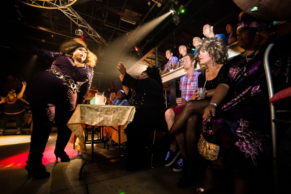 Bohemia Rothschild and Acaicai Phillips watch as local drag queen Odyssey Whitney performs in a drag pageant at Club Luxor. Both drag queens and kings performed for the judges.