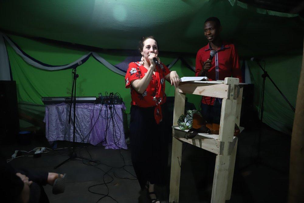 Amanda speaking at the tent revival.