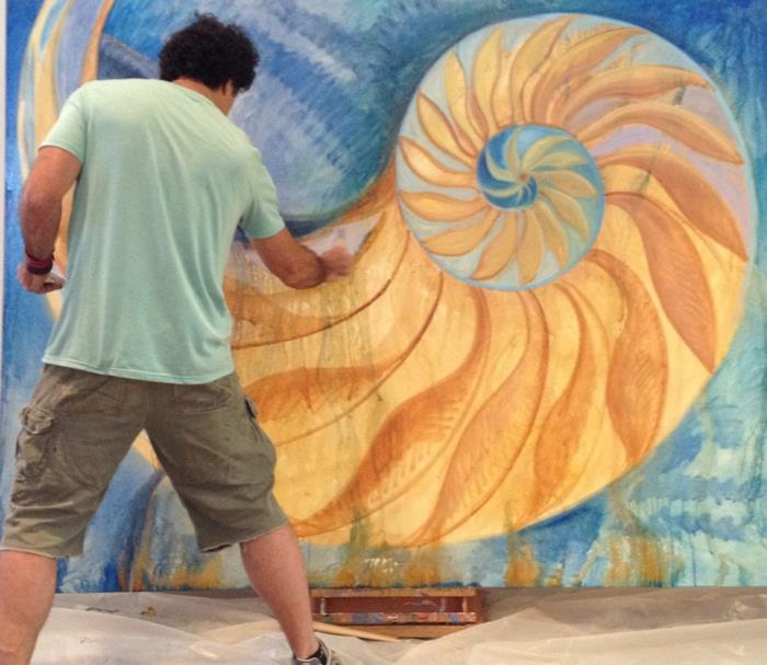 September 2012.  Perry Milou painting a nautilus to display at PJS