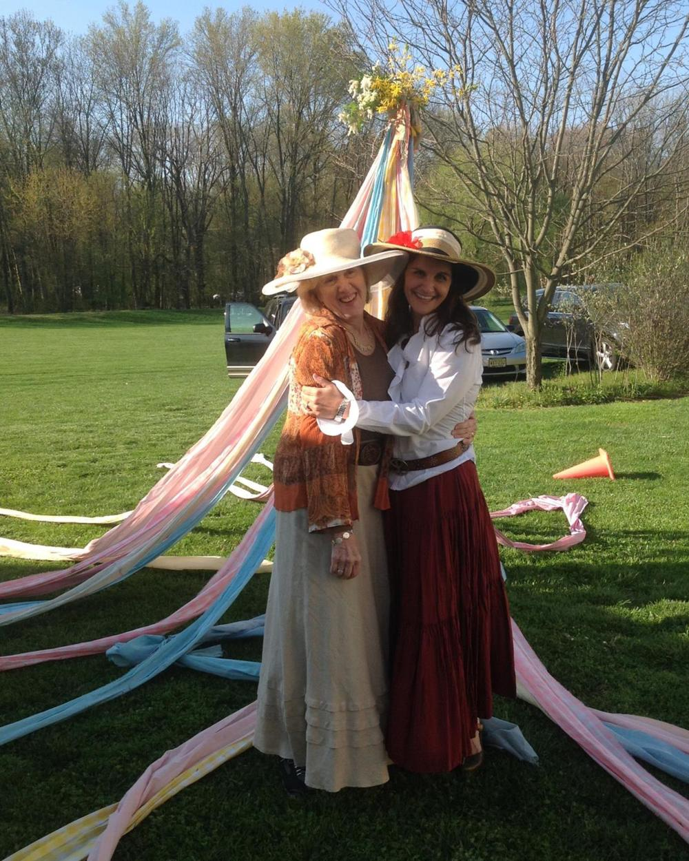 Co-founder, Juliana McIntyre Fenn, and Silvana Clark prepare to dance around the maypole in celebration of Founders' Day