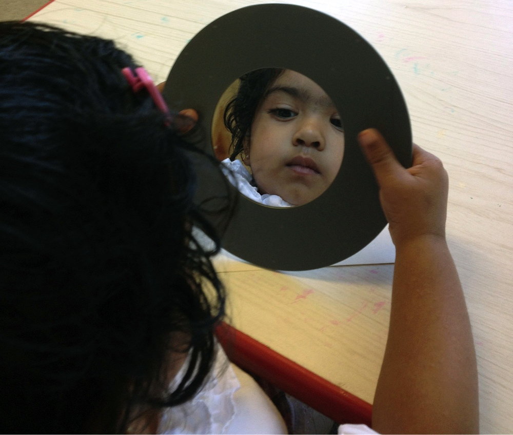 toddler in mirror crop.jpg