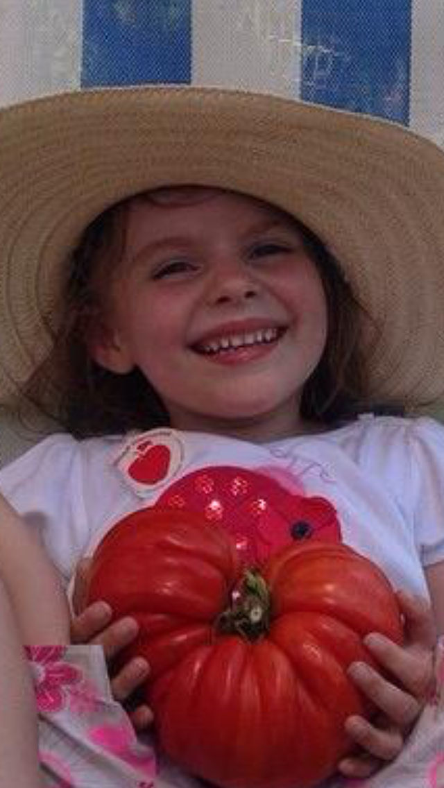 ...and for the best sauce ever from Nona Ferrante's home garden. Madison, that tomato is as big as your head!