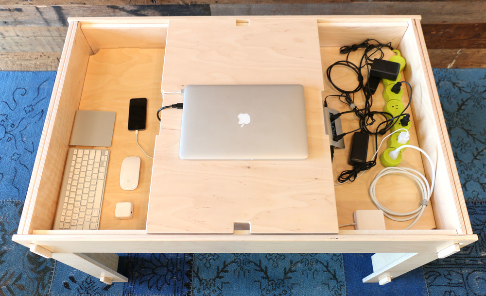 Peripherals and accessories like power strips and USB hubs can be completely concealed inside the compartment