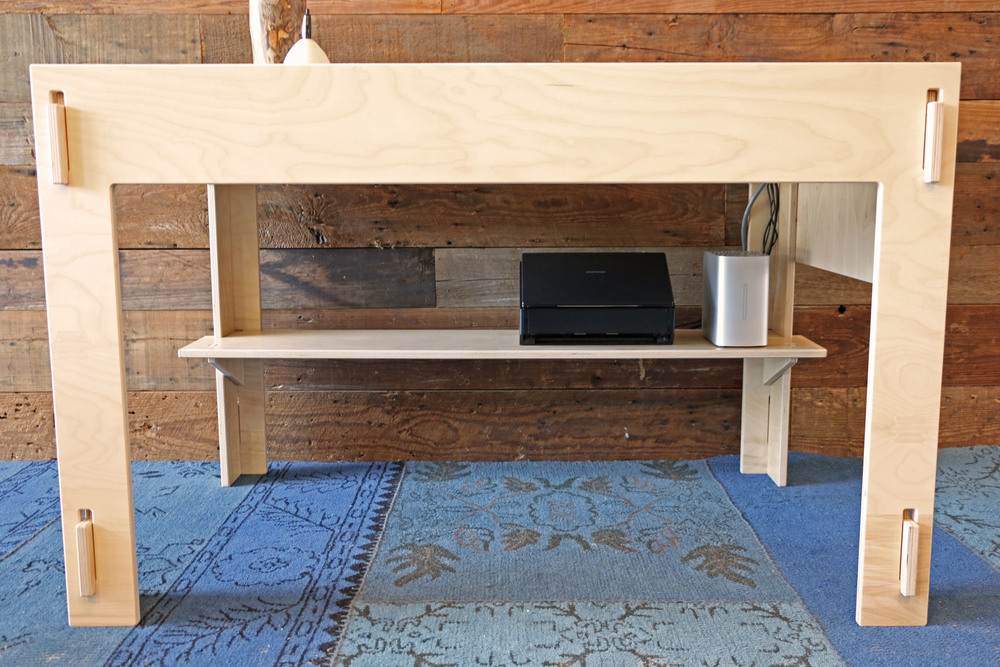 Full-width shelf holds peripherals and supplies
