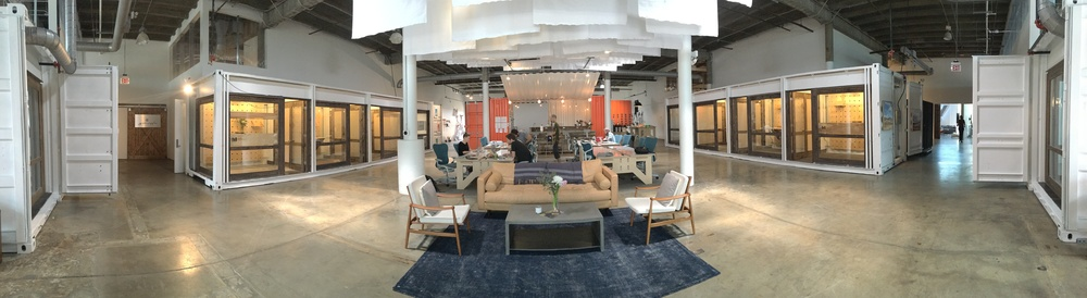 Panorama of the WELD Nashville space showing two installed SuperCubes (extreme left and right sides of the pic). The common area with four WELD Tables is visible in the center.