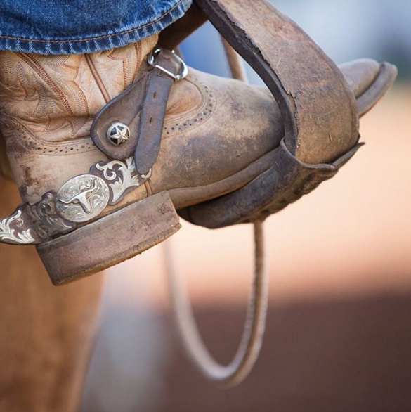 Hana Ranch_Boots spurs in stirrup.png