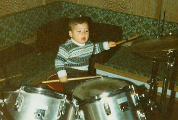 playing drums age 1 1:2.jpg