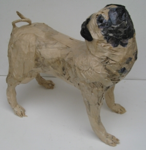 Pug wearing a skin-tight brown paper bag.