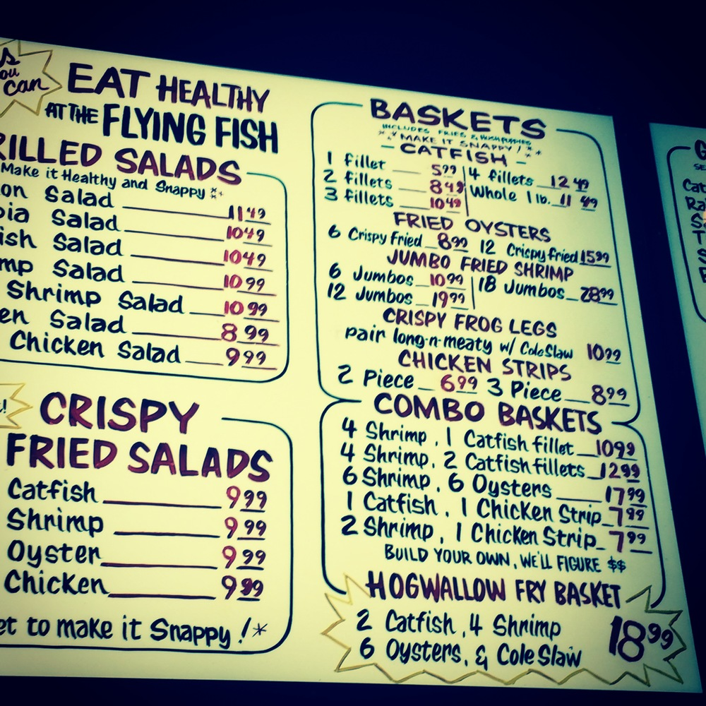The menu at the Flying Fish in Downtown Little Rock, Arkansas. Catfish, frog legs, fried oysters and hush puppies. Definitely, my kind of road food.