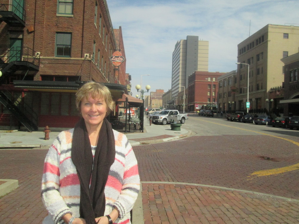 Linda Hubka, the on-site market manager, stands in the Haymarket where the streets will begin to be lined with tents.