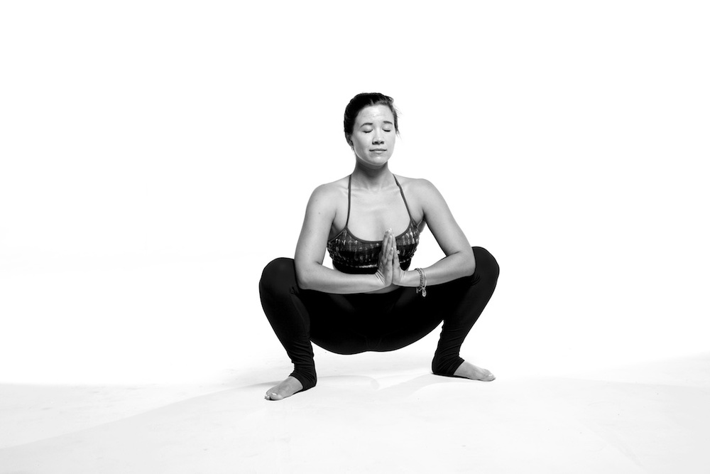 This is Sarah, one of our amazing teachers.  This squat is a great prep for Crow. Photo by the talented Mohamud Mumin.