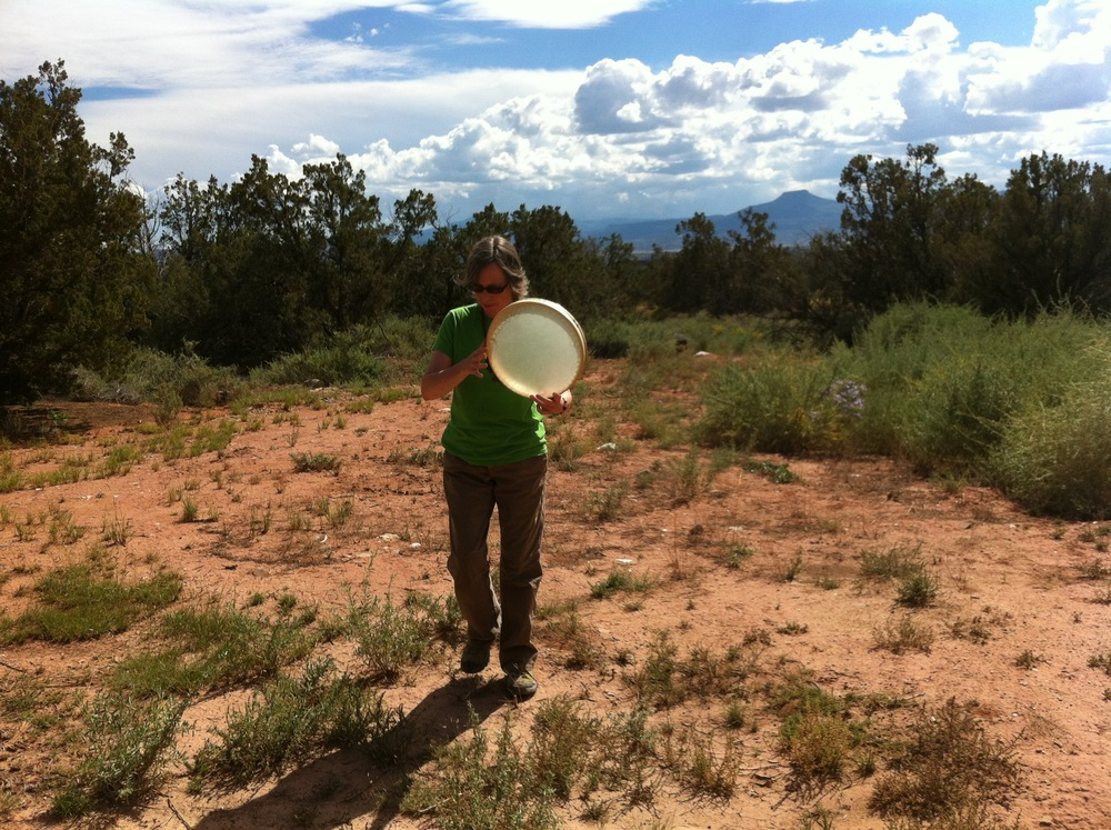 DrumFlower - Empowering Women One Beat at a Time. Lesley Tao Mowat drumming with the land in New Mexico. Photo © Damini Celebre.