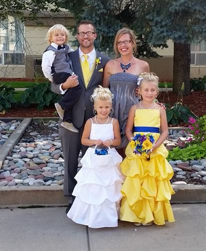 Ashley Robillard, with her husband, two daughters and son.