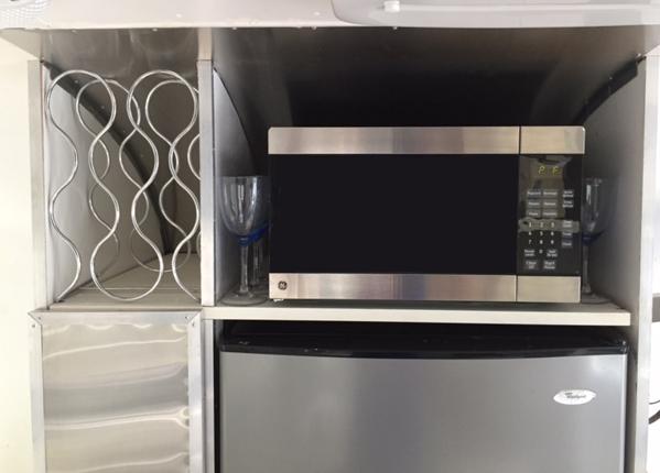 Microwave and wine rack