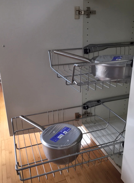 Slide out shelving in cabinet