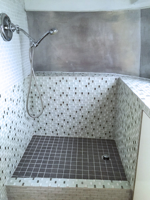Glass, ceramic, and brushed aluminum shower with Moen shower wand