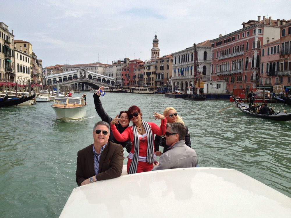 The Gang!  On a water Taxi in t e canals of Venice.