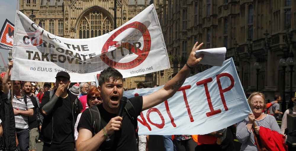 12/07/2014 - Protestors against the EU-US trade deal (TTIP - Transatlantic Trade and Investment Partnership) outside the Houses of Parliament march to Europe House, the London Headquarters of the European Commission and the European Parliament, in Smith Square, London.