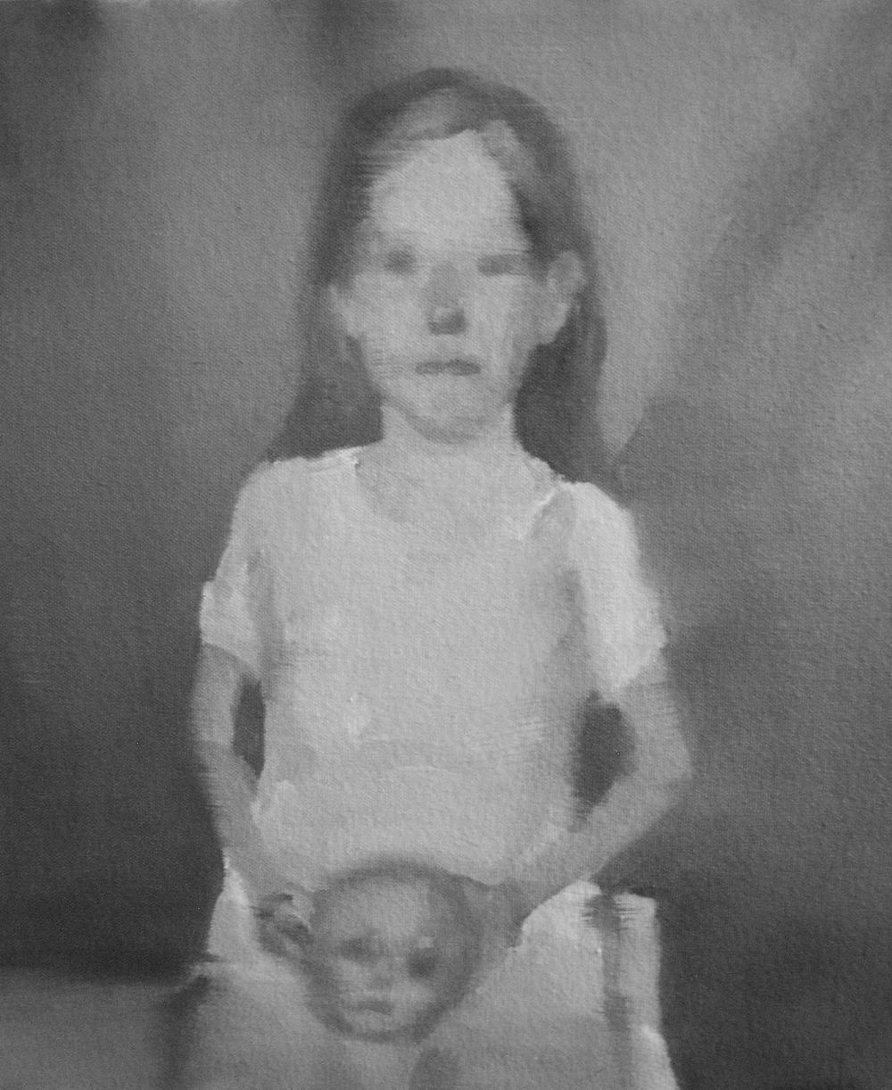 Little Girl Holding Doll's Head