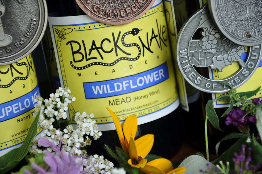 Wildflower Honey Wine (2011 Bronze Medal, Dry Traditional, International Mead Festival): - This dry mead is special! ALL of the honey is from our own hives. No sulfites added. Flavors and aromas will vary with season. Gluten-free. $18/ 750 mL.Click to order on VinoShipper.