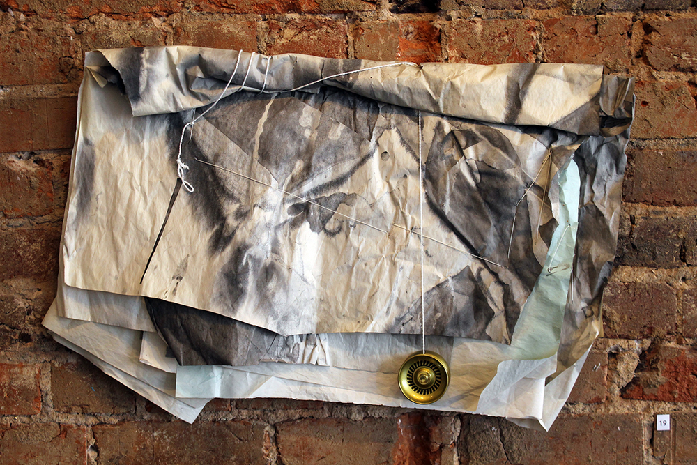 Yo , Harriet Hoover & Amy S. Hoppe, 2015, ink, acrylic spary paint, packing paper, string, and yo-yo