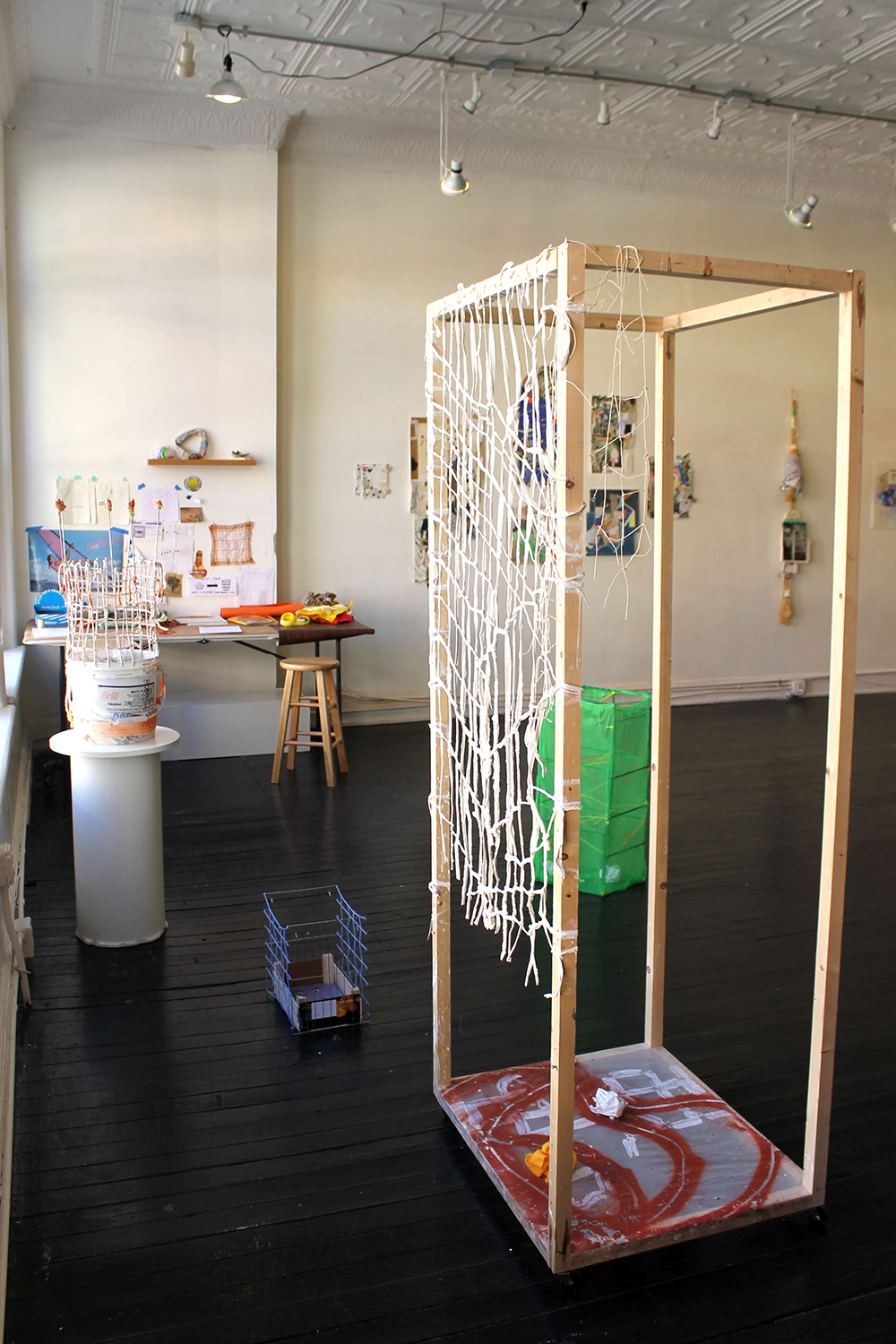 Best Shot , Harriet Hoover & Amy S. Hoppe, 2015, interactive installation  Throughout the exhibition, visitors were invited to create a sculpture using Hoover & Hoppe's studio materials and aim for the sculptural goals provided.