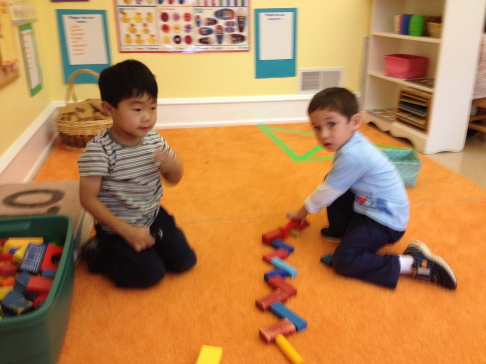 Peter and Jonas built with the colored blocks.