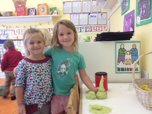 Cora and Grace made a cool sculpture with the play dough Gus' mom made.