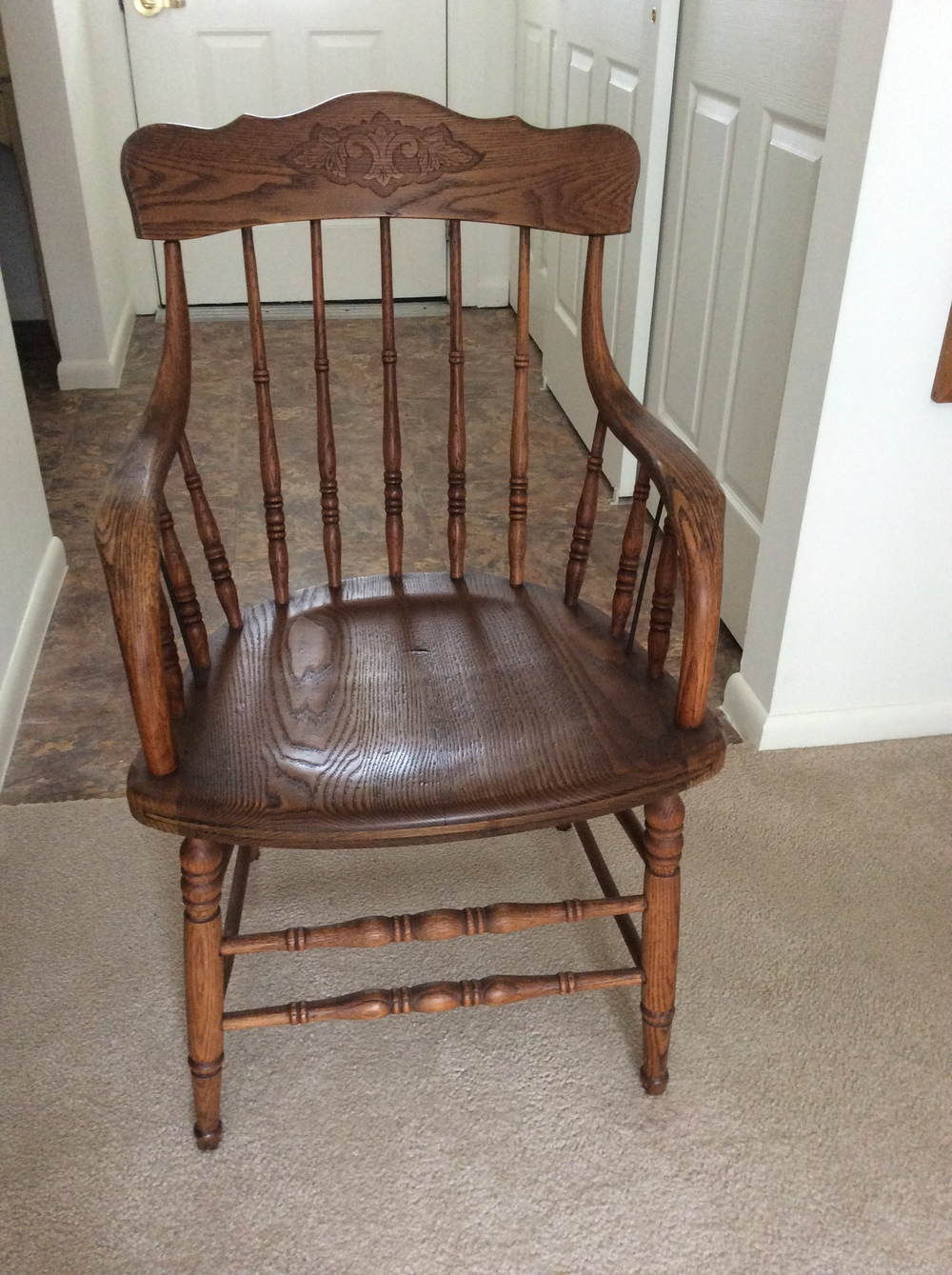 Oak pressed back arm chair, turned spindles, circa 1940.  $50 estimated value