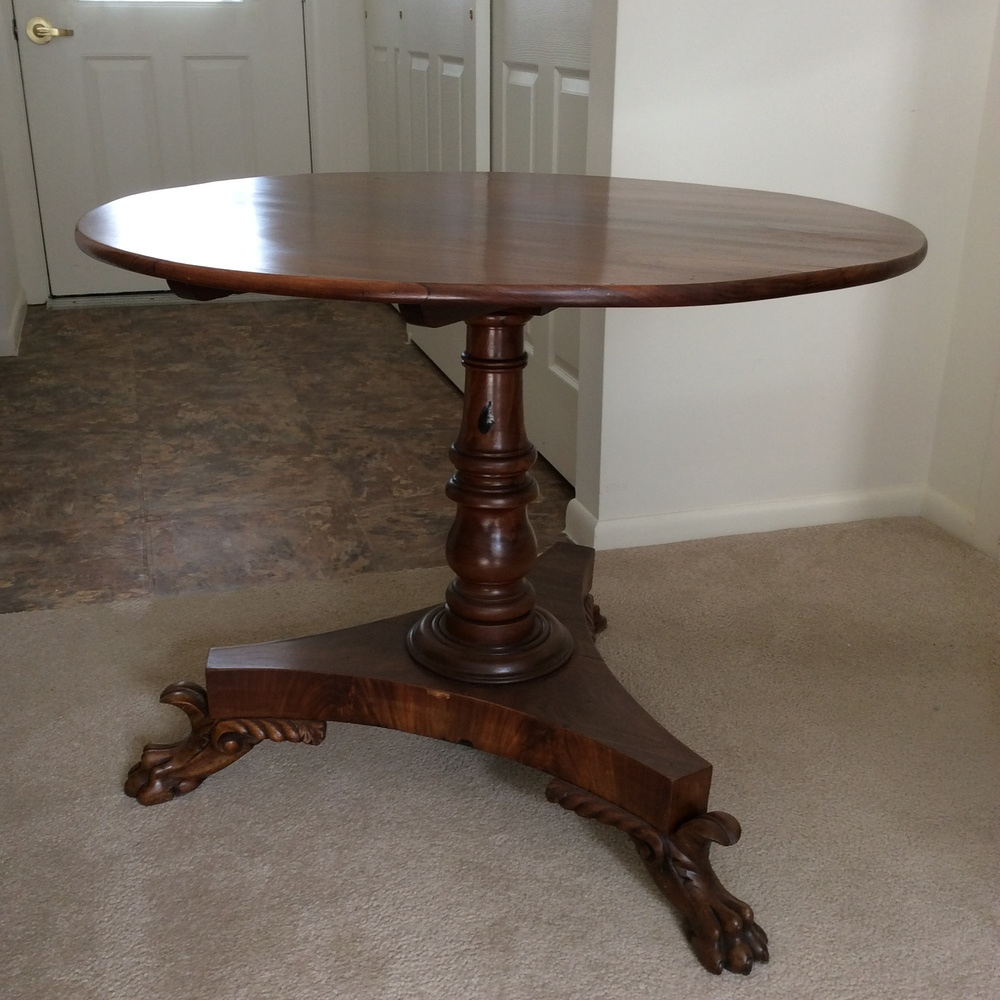 Empire mahogany round tilt top table, great carving and veneered base mechanism sound.   $750 estimated value