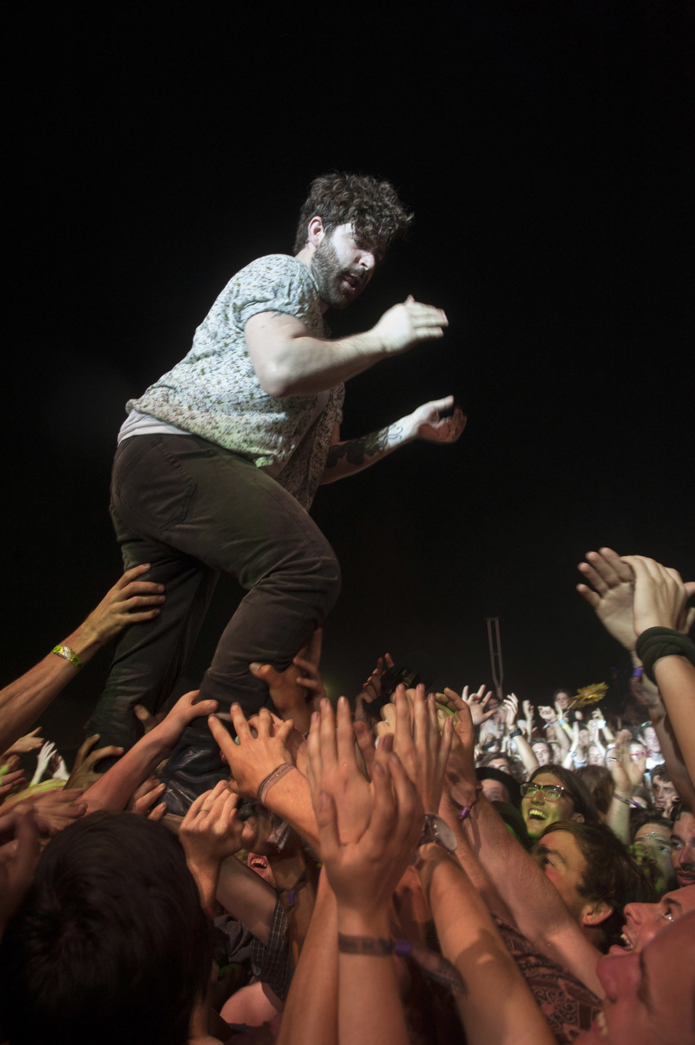 Yannis Philippakis, lead singer and guitarist of British indie group Foals crowd surfs after ringing in the New Year at Falls Festival - image courtesy of Kirsty Umback.